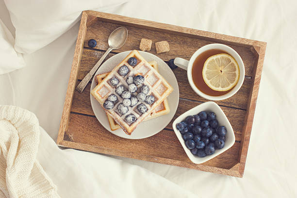 breakfast in bed,  tray with belgian waffles with blueberry and stock photo