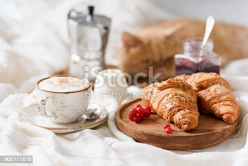 istock Breakfast in bed with coffee, croissants and jam 900171878