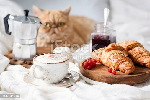 istock Breakfast in bed with croissants, coffee and jam. 896734040