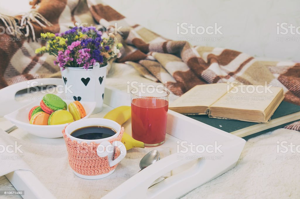 Breakfast in bed with hot coffee and macaroons. royalty-free stock photo