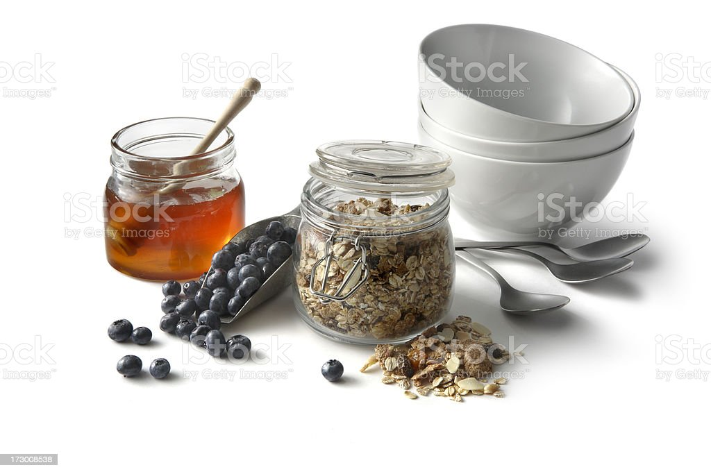 Breakfast Ingredients: Cereals, Blueberries and Honey Isolated on White Background royalty-free stock photo