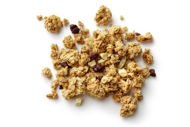 breakfast ingredients: granola isolated on white background - muesli imagens e fotografias de stock