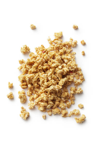 breakfast ingredients: granola isolated on white background - granola imagens e fotografias de stock