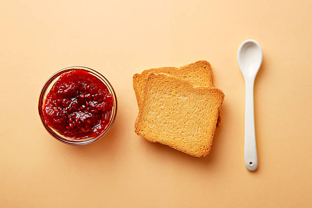 Breakfast ingredients. Jam and toast bread. Top view stock photo