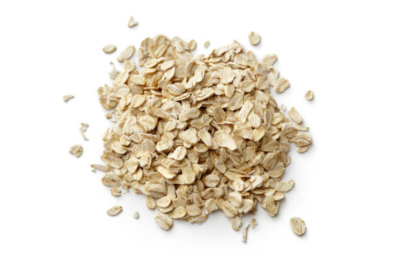 breakfast ingredients: oats isolated on white backgroundbreakfast ingredients: - oats food stock photos and pictures
