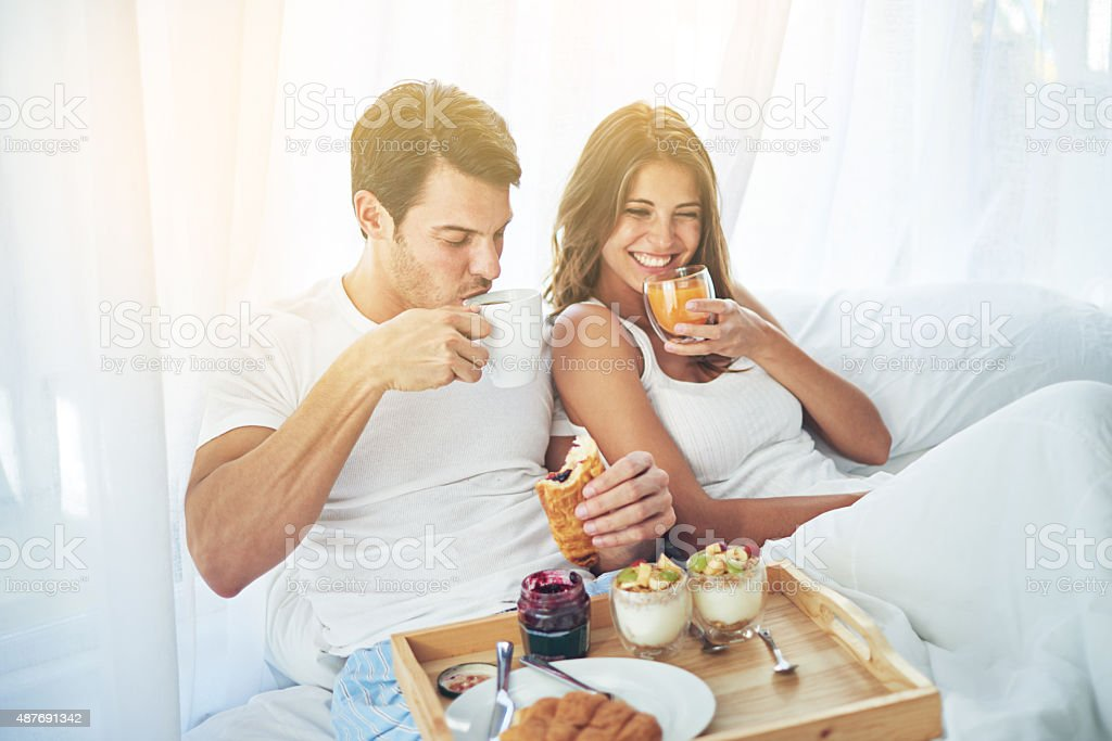 Breakfast is better when you share it in bed stock photo