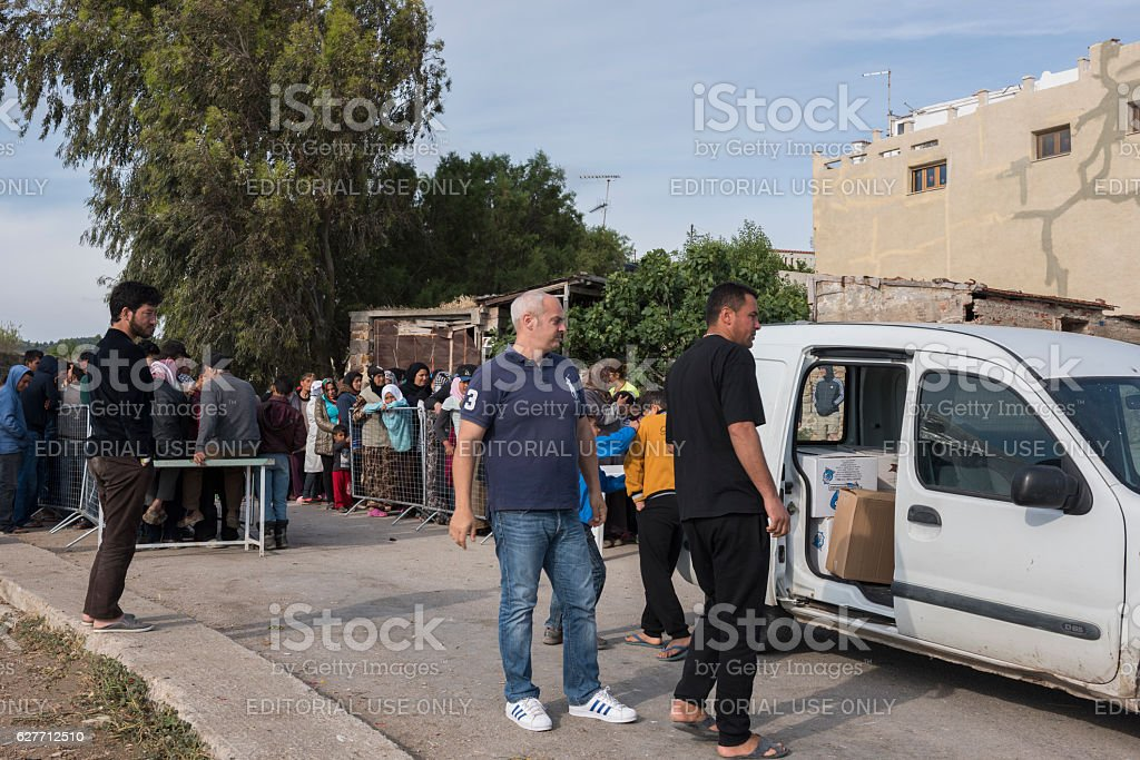 Breakfast line in Souda refugee camp on Chios royalty-free stock photo