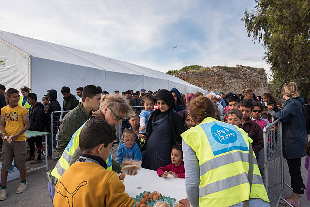 Breakfast line in Souda refugee camp on Chios stock photo