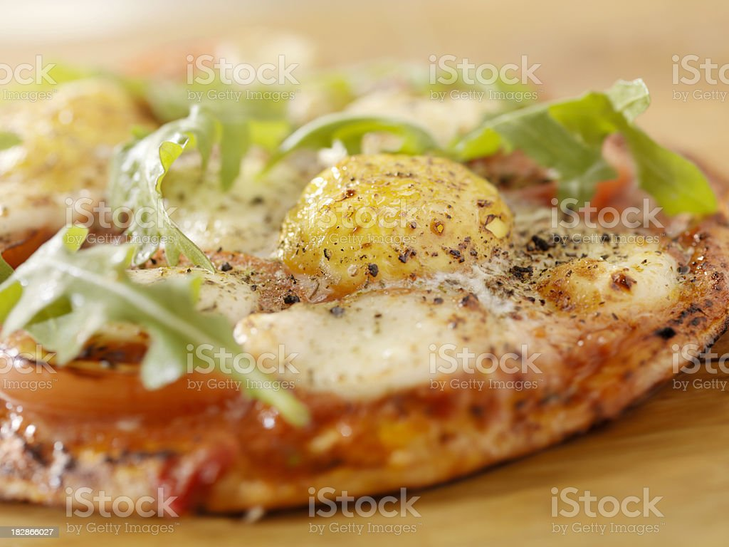 Breakfast Margharita Pizza with Eggs and Arugula on Flat Bread stock photo