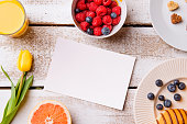 Breakfast meal. Empty greeting card. Studio shot, wooden backgro