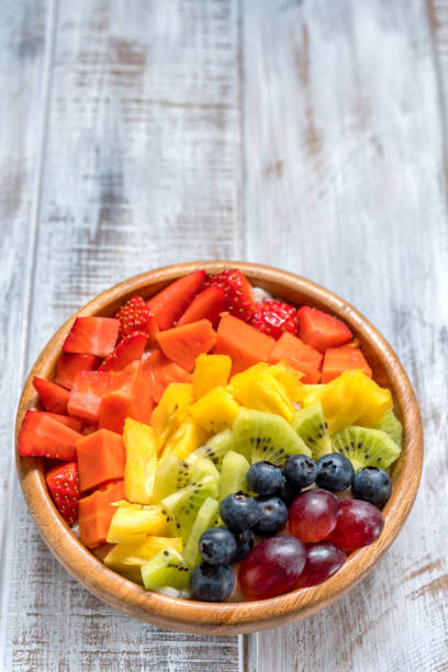 breakfast oatmeal for kids topped with rainbow fruits - oats food stock photos and pictures