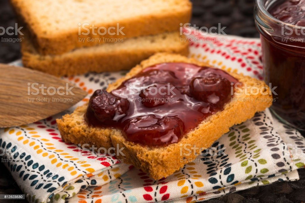 Breakfast of cherry jam on toast stock photo