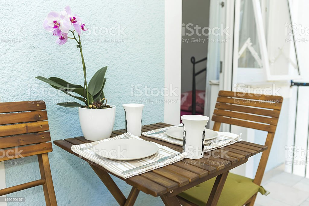 Breakfast on terrace with bright pink and white flower stock photo