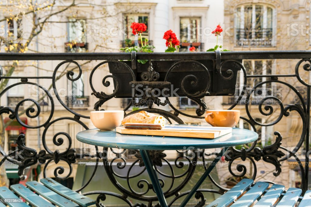 Breakfast on the balcony in Paris in springtime stock photo