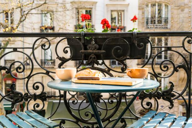 Breakfast on the balcony in Paris in springtime stock photo