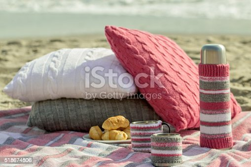 istock Breakfast on the beach. Coffee and croissants on the sea. 518674806