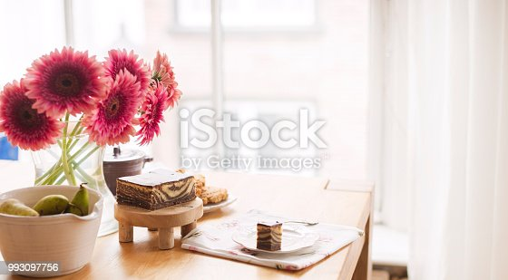 697868238 istock photo Breakfast on the table by the window. A bouquet of flowers and coffee. Good morning. Copy space 993097756