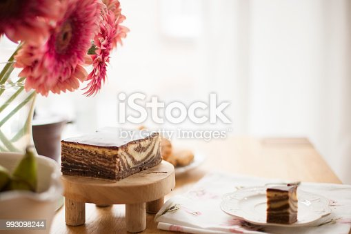 697868238 istock photo Breakfast on the table by the window. A bouquet of flowers and coffee. Good morning. Copy space 993098244