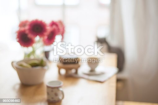 697868238 istock photo Breakfast on the table by the window. A bouquet of flowers and coffee. Good morning. Copy space. Blurred Background 993098460