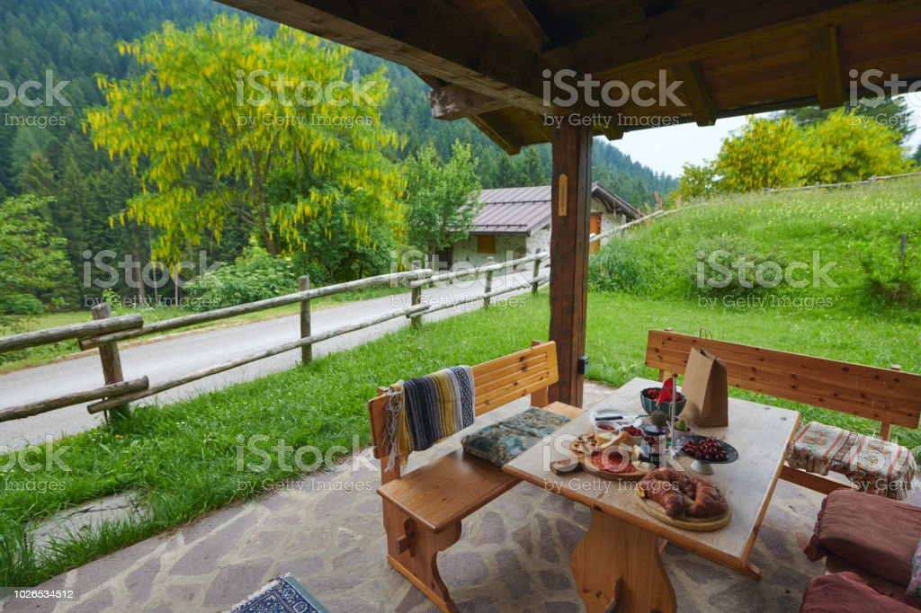 Breakfast outdoors in the Dolomites stock photo