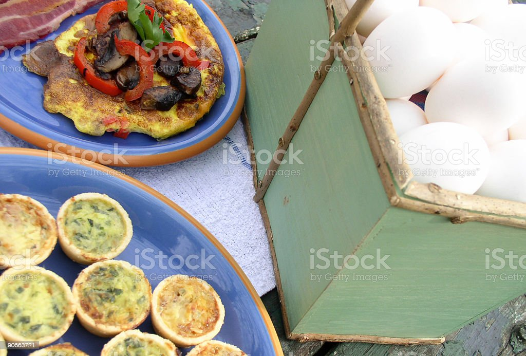 Breakfast outdoors - Omelette, Quiche, Eggs and Bacon stock photo