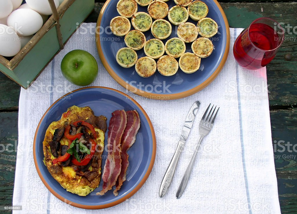 Breakfast outdoors - Omelette, Quiche, Juice and Bacon stock photo