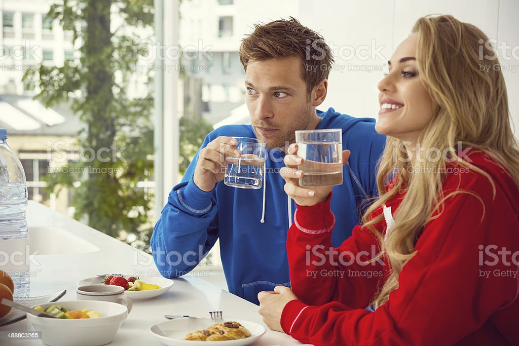 Breakfast Young couple sitting in the modern kitchen in the morning and having breakfast.  20-24 Years Stock Photo