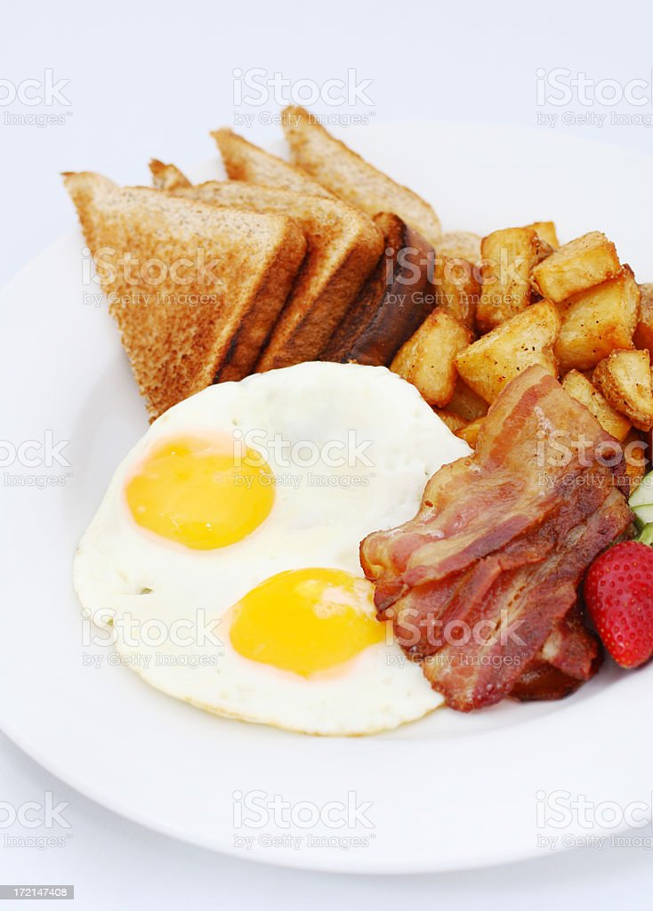 Breakfast plate with eggs, bacon, toast and hash browns royalty-free stock photo