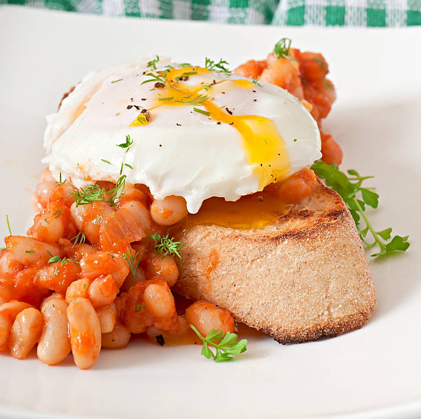 Breakfast - poached egg with toast stock photo
