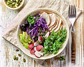 Breakfast power bowl foe healthy eating on wooden table, top view