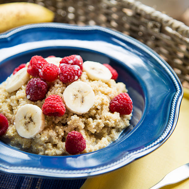 Breakfast Quinoa with Raspberries and Bananas Square A blue bowl filled with quinoa cereal topped with bananas and raspberries.Similar Images: quinoa stock pictures, royalty-free photos & images