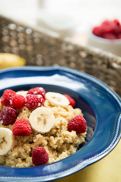 Breakfast Quinoa with Raspberries, Bananas and Copy Space Bowl of quinoa cereal with raspberries and bananas.  A small amount of copy space is available at the top of the image.Similar Images: quinoa stock pictures, royalty-free photos & images