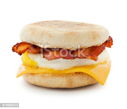 Bacon breakfast sandwich with egg and cheese slice isolated on white (excluding the shadow)