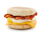 Bacon breakfast sandwich with egg and cheese slice isolated on white - clipping path included (excluding the shadow)