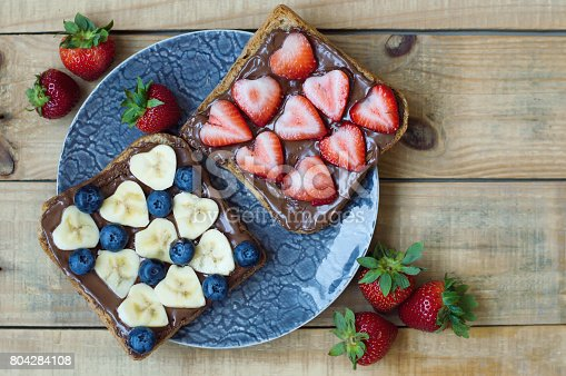 640978994 istock photo Breakfast sandwiches with chocolate butter, banana slices, strawberry and blueberry 804284108