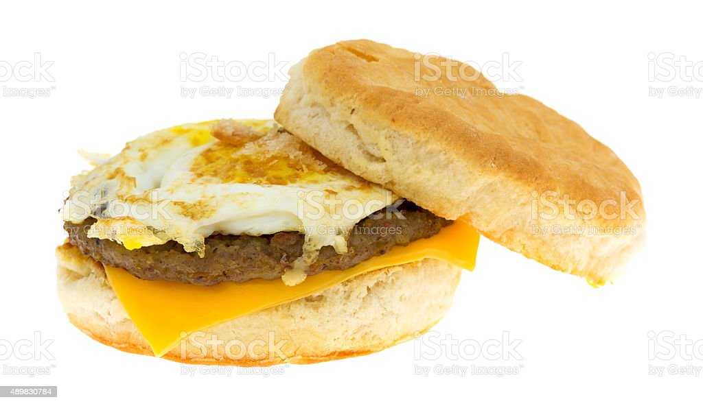 Breakfast sausage egg and cheese biscuit on a white background stock photo