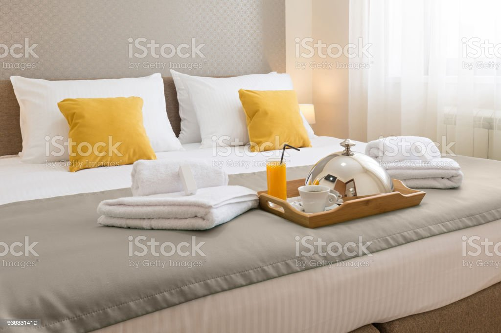 Breakfast served on a hotel bed stock photo