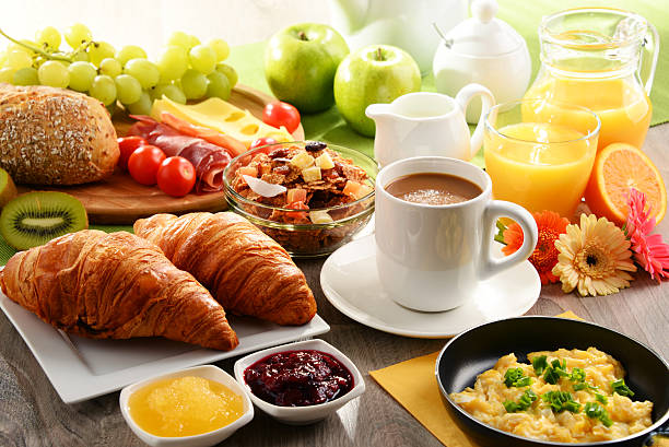 breakfast served with coffee, juice, egg, and rolls - ontbijt stockfoto's en -beelden