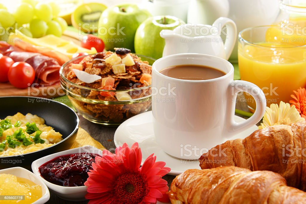 Breakfast served with coffee, juice, egg, and rolls – Foto