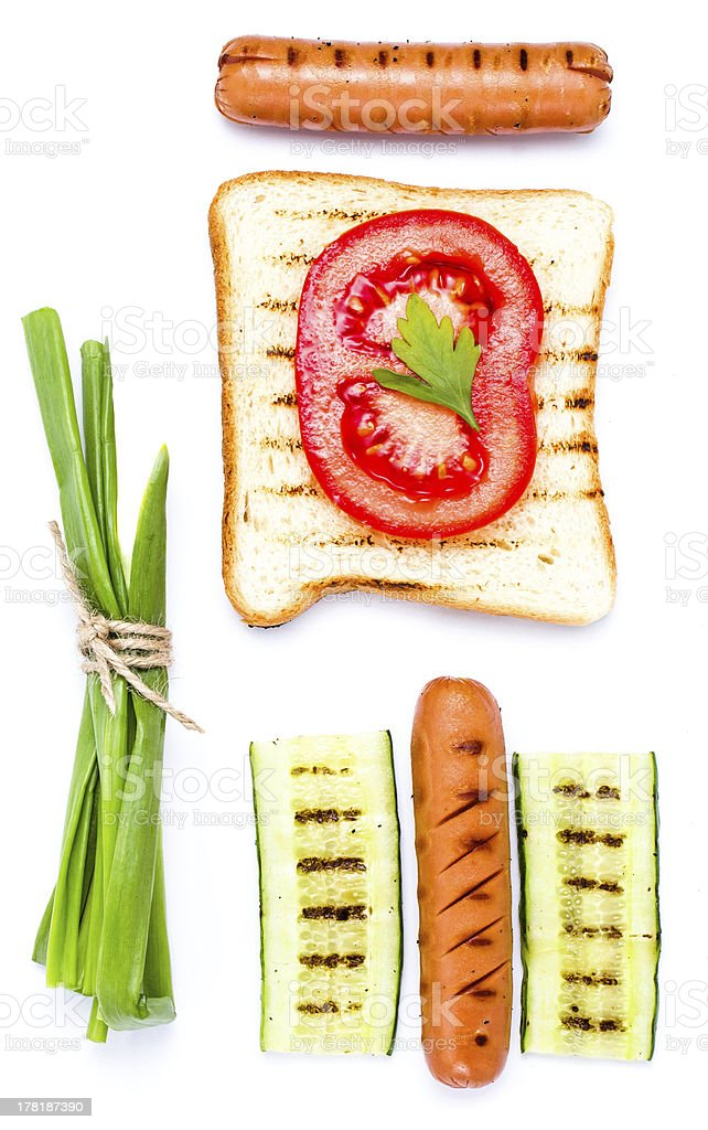 Breakfast set of toast bread, tomato, sausage and herbs, royalty-free stock photo
