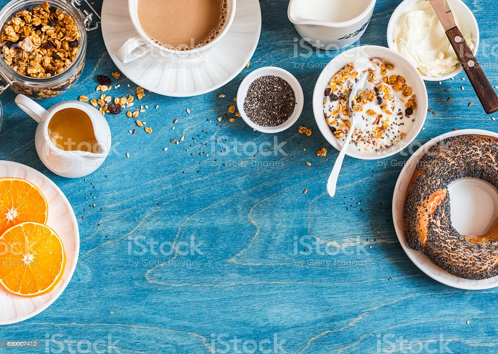 Breakfast setting over blue table with copy space border. stock photo