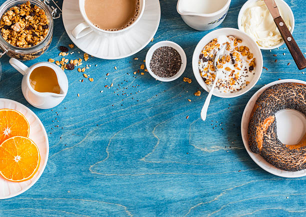 breakfast setting over blue table with copy space border. - breakfast stock photos and pictures