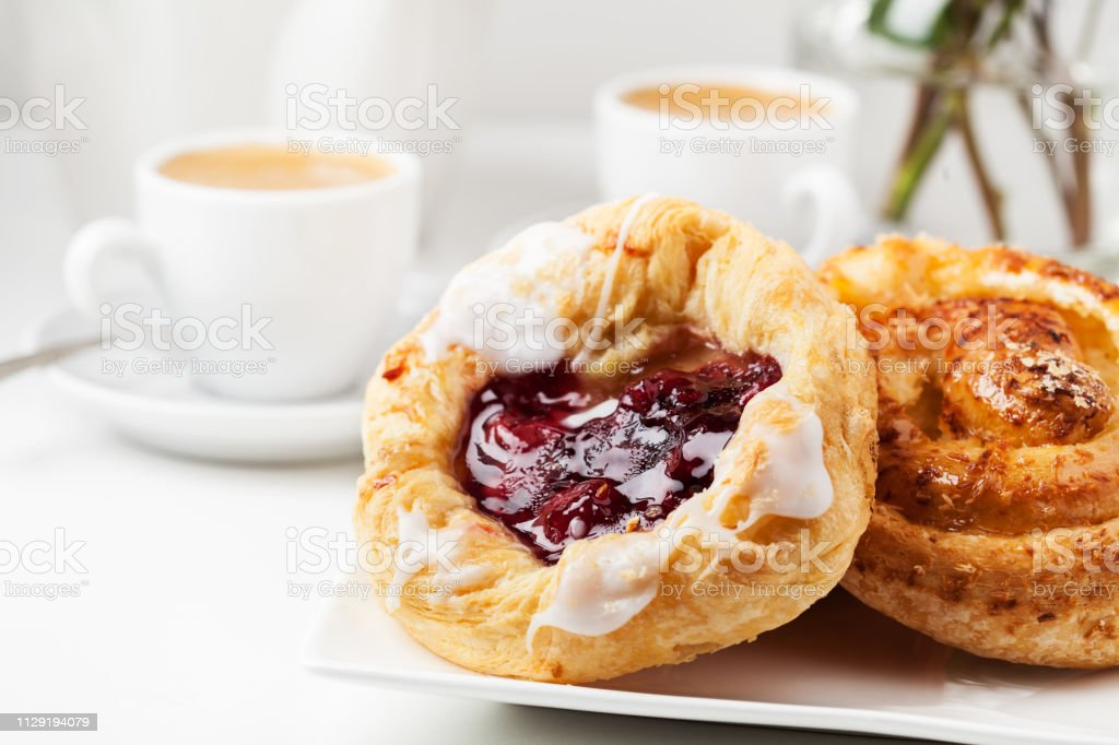 Breakfast setup with Danish pastries and coffee Romantic breakfast setup with Danish pastries and coffee Baked Pastry Item Stock Photo