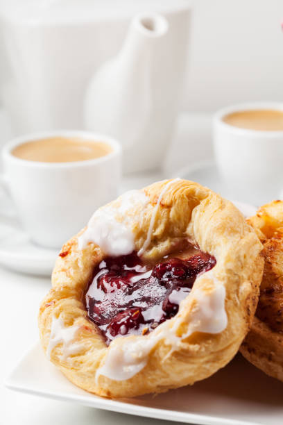 Breakfast setup with Danish pastries and coffee stock photo