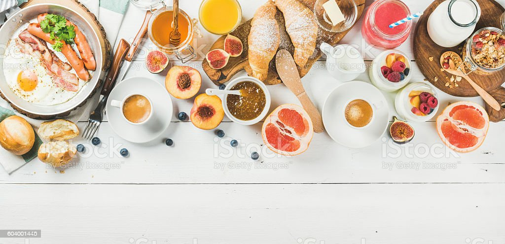 Breakfast snacks and drinks set on white wooden background stock photo