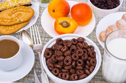 840939766 istock photo Breakfast table with croissant, muesli, milk, honey and fruits 816015276