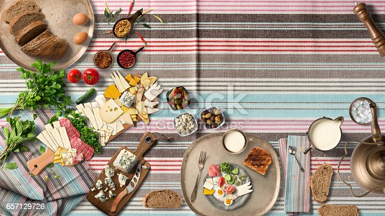 istock Breakfast table with great vegetable and cheeses from top view 657129726