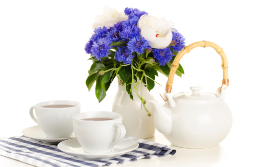 Breakfast tea on table with bouquet