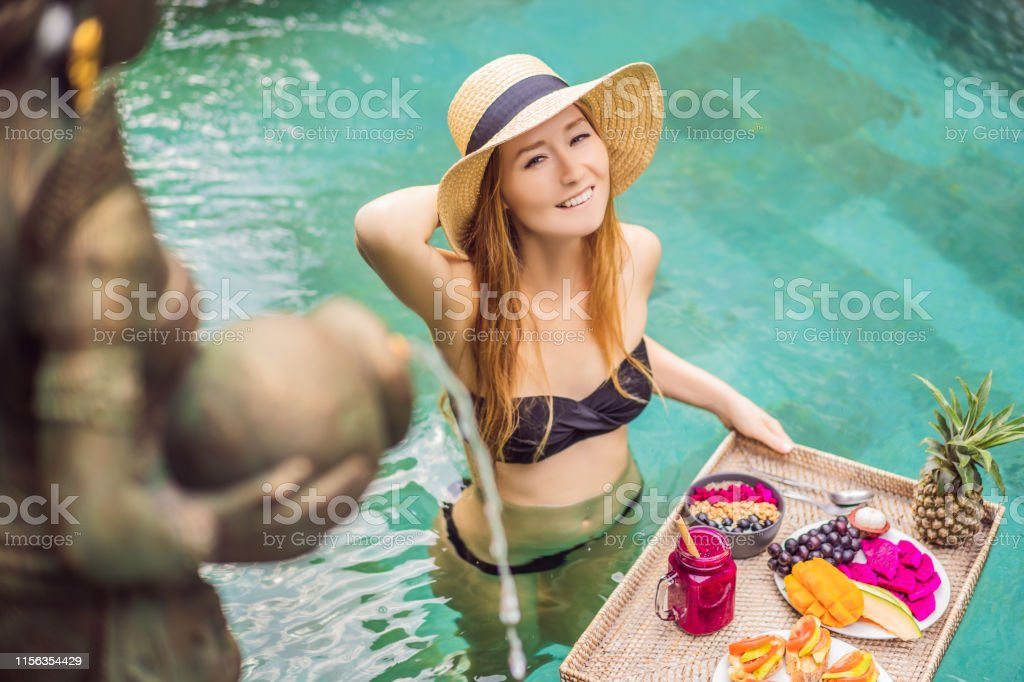 Breakfast tray in swimming pool, floating breakfast in luxury hotel....