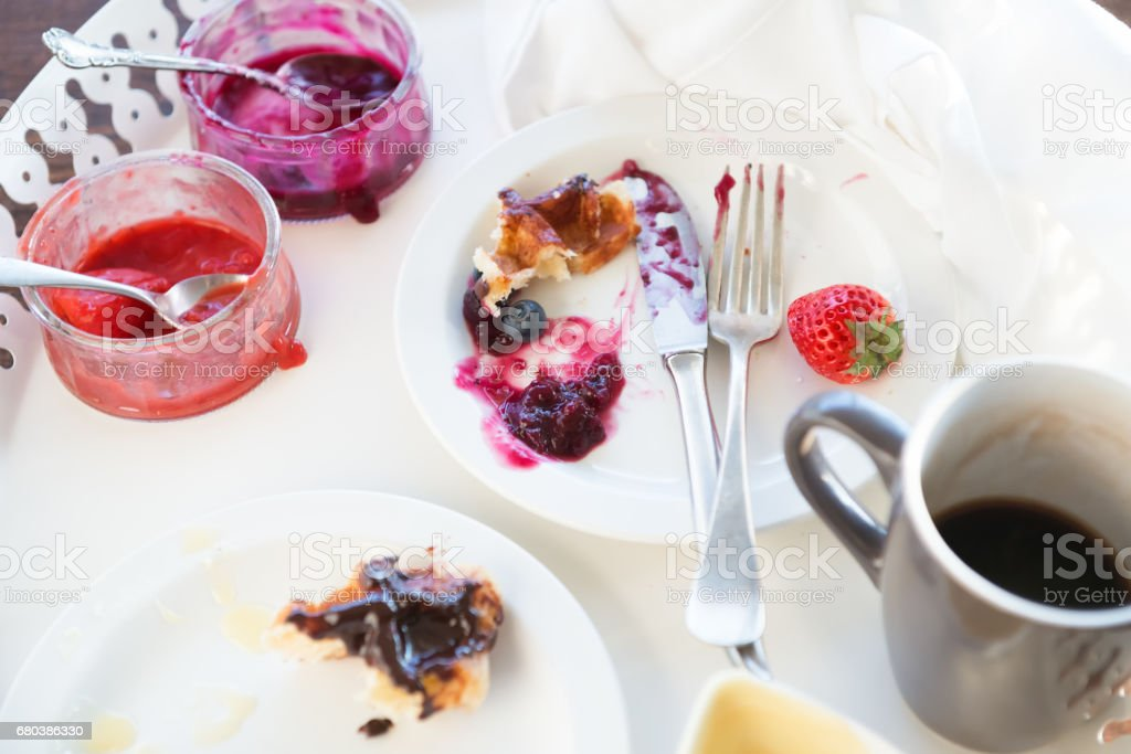 Breakfast Tray with Dirty Dishes, Leftover Waffles and Unfinished Coffee royalty-free stock photo